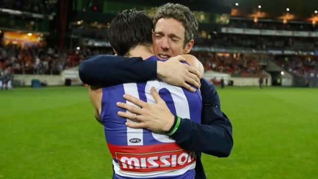 Full of heart: Injured Bulldogs skipper Bob Murphy embraces his stand-in, Easton Wood, after the Bulldogs beat GWS.