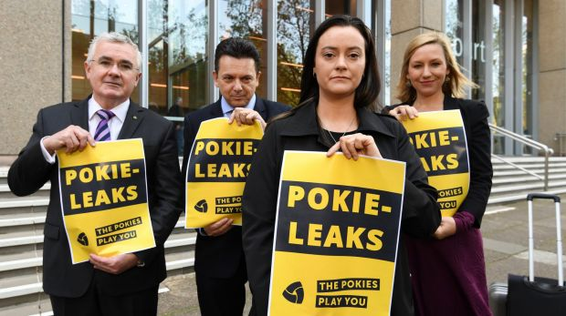 Greens deputy leader, Larissa Waters, Andrew Wilkie MP, Senator Nick Xenophon, and former pokie machine victim, Shonica ...
