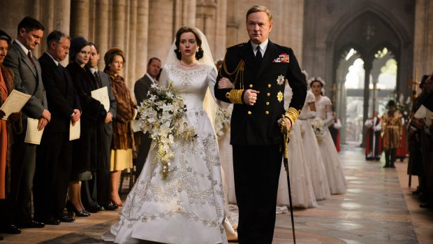 Claire Foy as Queen Elizabeth II and Jared Harris as King George VI in <i>The Crown</i>.