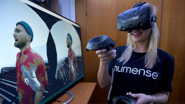 Co-founder Amber Cordeaux using Humense's human-to-human virtual reality software with a Vive headset.