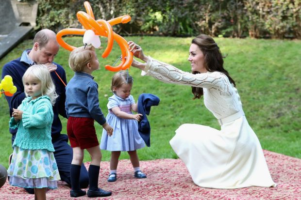 The Duchess of Cambridge entertains Prince George with a spider balloon at a children's party for Military families ...