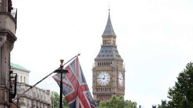 A British Union flag outside the Houses of Parliament.