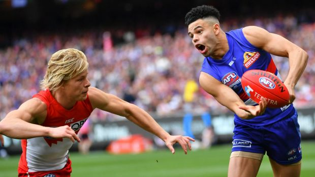 The Sydney Swans' Isaac Heeney attempts to thwart the handball-happy Bulldogs – and Jason Johannisen – in the 2016 grand ...