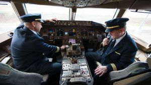 United Airlines Captain Tommy Holloman, left, and Captain Chuck Stewart, in the cockpit of an United Airlines Boeing 777 ...