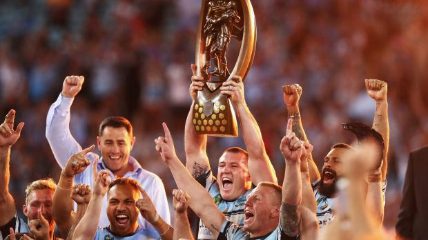 Long time in the making: Paul Gallen holds aloft the NRL premiership trophy.
