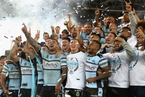 The Cronulla Sharks celebrate their victory over Melbourne Storm.