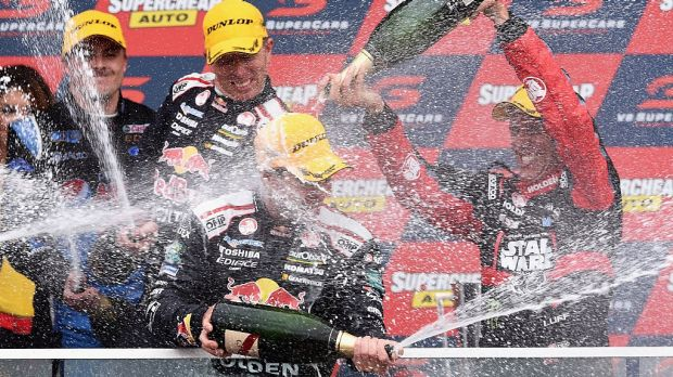 King of the Mountain: Craig Lowndes  and Steven Richards of Holden VF Commodore celebrate after winning the 2015 ...