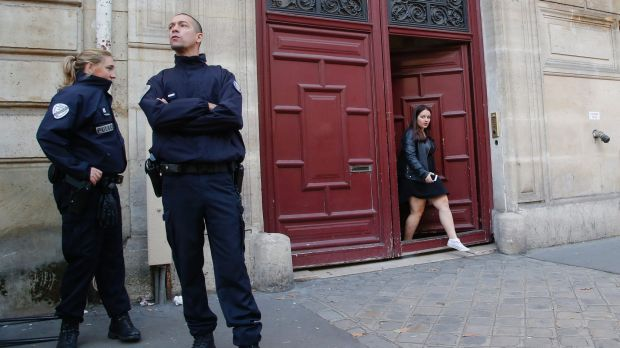 French police officers outside the residence of Kardashian West in Paris following the robbery.