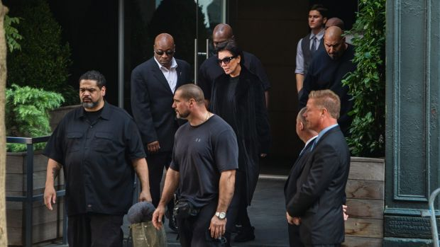 Kardashian West's mother Kris Jenner surrounded by security as she leaves the New York residence where her daughter is ...