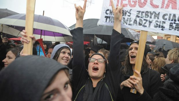 Polish women shout slogans during a demonstration during the nationwide strike.
