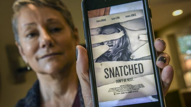 Wendy Mueller displays the image her daughter texted to her in the middle of a virtual kidnapping scam.