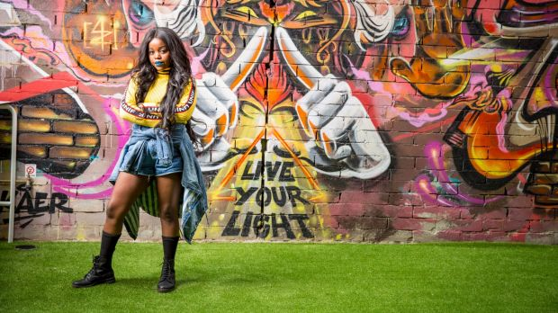 Tkay Maidza in front of the graffiti wall at Brisbane's Chur Burger.