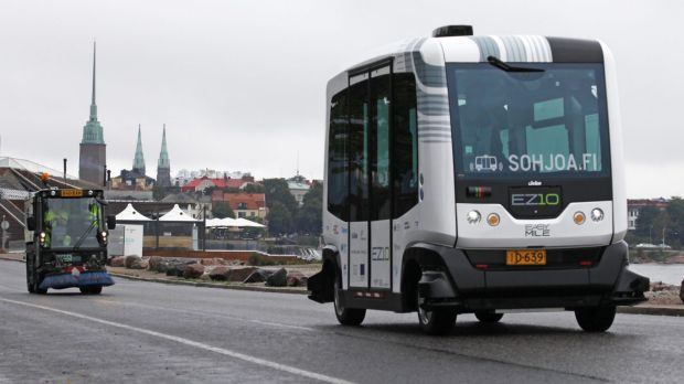 An EasyMile EZ-10 self-driving shuttle bus during testing as part of the Sohjoa pilot project in Helsinki, Finland, in ...