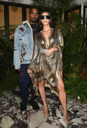 Kanye West with wife Kim Kardashian West at Paris Fashion Week in September, just a few days before she was robbed at ...