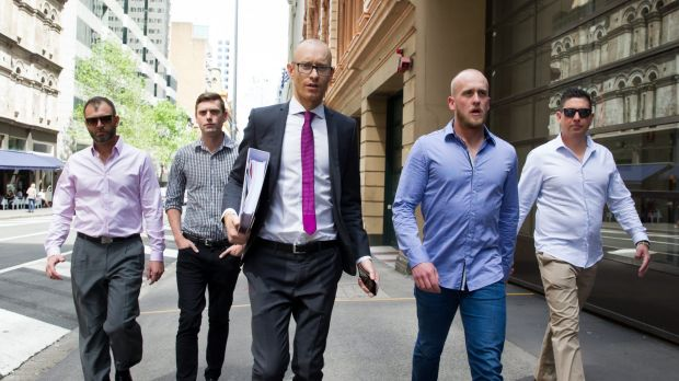 Shane Housego, Christian McDonald, Chris Sheehy and Steven Rapisarda join lawyer Nicholas Stewart (centre) to lodge ...