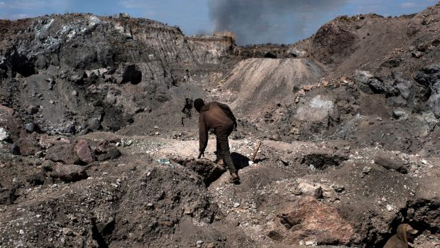 """A """"creuseur,"""" or digger, climbs through a cobalt and copper mine in Kawama, in the Democratic Republic of the Congo. ..."""