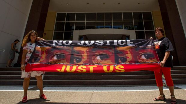 Protesters Theresa Rowe and Josephine Crawshaw outside the royal commission in Darwin.