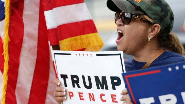 Angry and mobilised - but to where? Donald Trump supporter outside a rally for Democratic presidential candidate Hillary ...