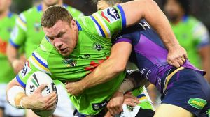 Shannon Boyd of the Raiders is tackled by Cooper Cronk.