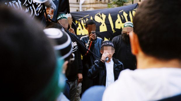 The 16-year-old boy arrested on Wednesday is pictured in 2012, then aged 12, speaking through a megaphone to rioters in ...