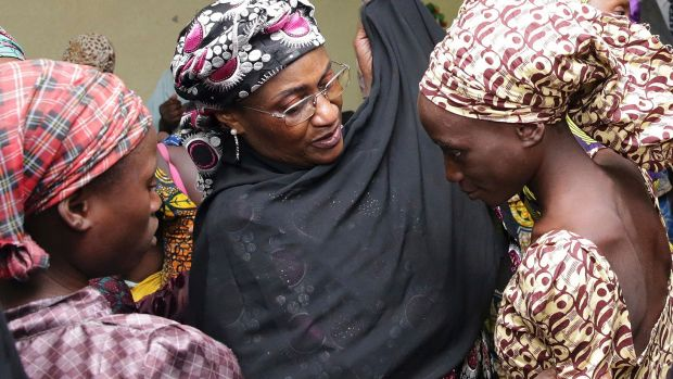 In an earlier incident in October, one of the released girls freed from Boko Haram is met by a Nigerian government ...