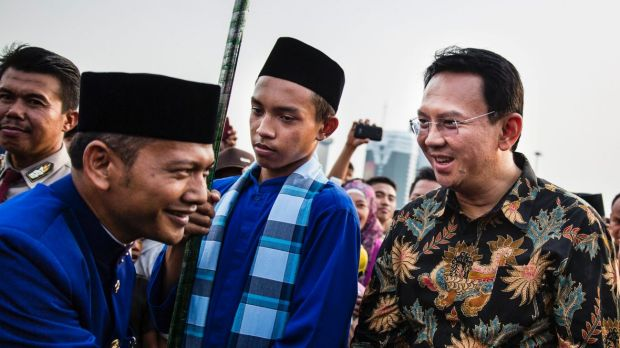 Ahok, right, in 2014. A Christian and ethnic Chinese, he became governor after his predecessor and political ally Joko ...
