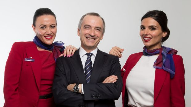 Virgin Australia CEO John Borghetti (centre) said a lack of competition on regional routes was hurting growth in ...