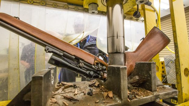 A gun being crushed at the Victoria Police Forensic Centre in Macleod.