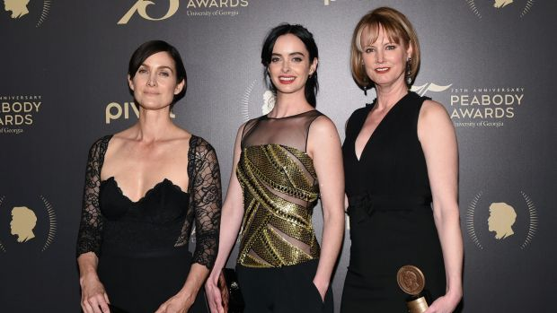 Jessica Jones actors Carrie-Anne Moss (left) and Krysten Ritter with creator Melissa Rosenberg.