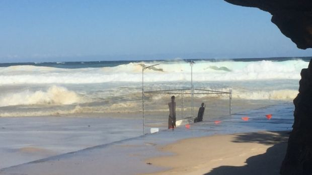 Large swell rolls towards the artwork 'Fair Dinkum Offshore Processing', which was destroyed.