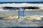 King tide surrounds a sculpture by Rebecca Rose at Tamarama Beach.