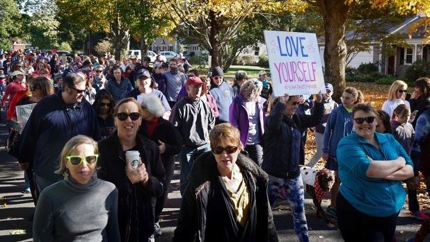 Hundreds of women, girls and other supporters proudly donned their yoga pants as they peacefully paraded around the ...