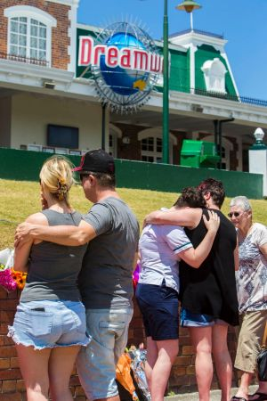 Locals grieve outside Dreamworld on Wednesday following Tuesday's fatalities.