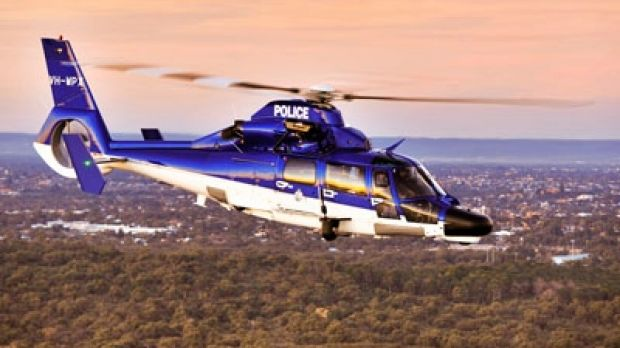 A man has been charged after targeting a police helicopter as it flew over Butler.