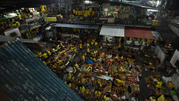 Some of the 3562 inmates sleep on any available space on the basketball court in jail in Manila, Philippines. The ...