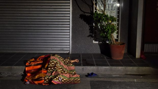 One of two people killed in a double shooting in the Manila suburb of Baclaran lies in the street.