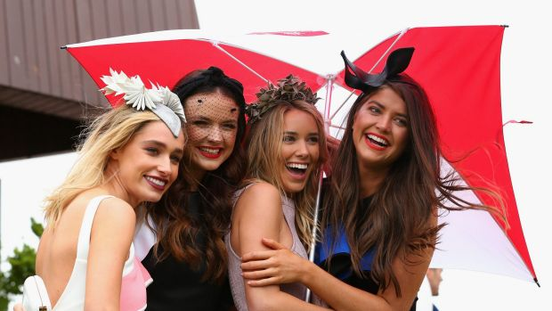 An umbrella was an essential accessory on Tuesday's Melbourne Cup.