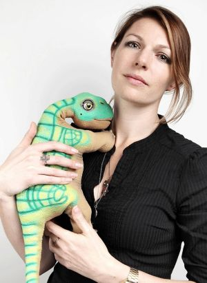 Kate Darling, research specialist at MIT Media Lab, with Peter, her pet Pleo baby dinosaur. Yoshi, another Pleo pet, ...