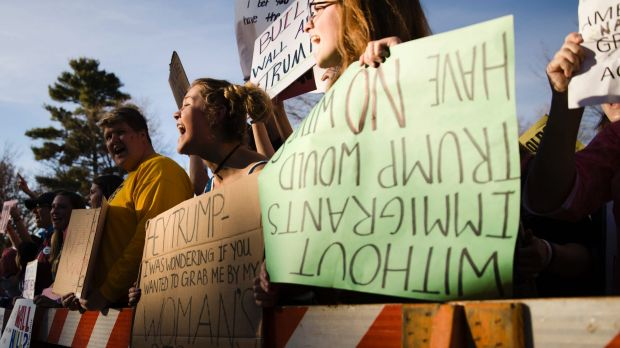 Protesters demonstrate ahead of a campaign stop by Donald Trump at the University of Wisconsin.