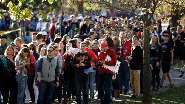 People wait to enter the Trump event at the University of Wisconsin.