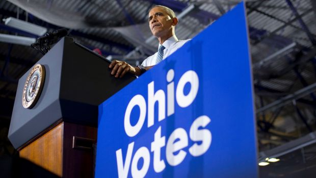 President Barack Obama pauses while speaking at Capital University Field House in Columbus, Ohio, on Tuesday.