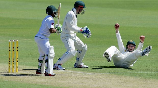 Shaun Marsh catches Temba Bavuma on day one of the first Test at the WACA.