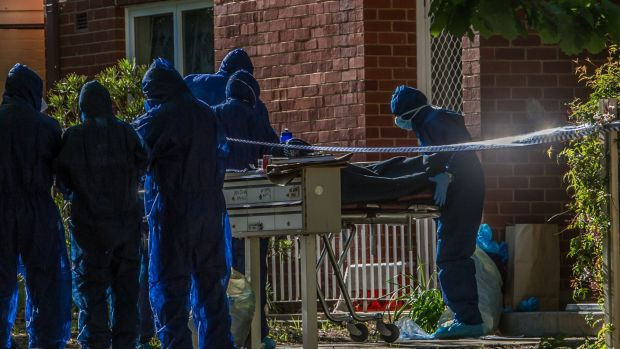 Police remove a dead body from a block of flats in Windeyer street Watson.