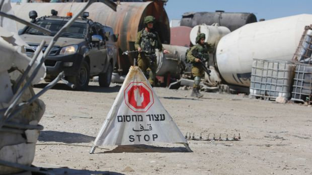 Israeli soldiers set up a security checkpoint  near the occupied West Bank village of Hebron earlier this year.