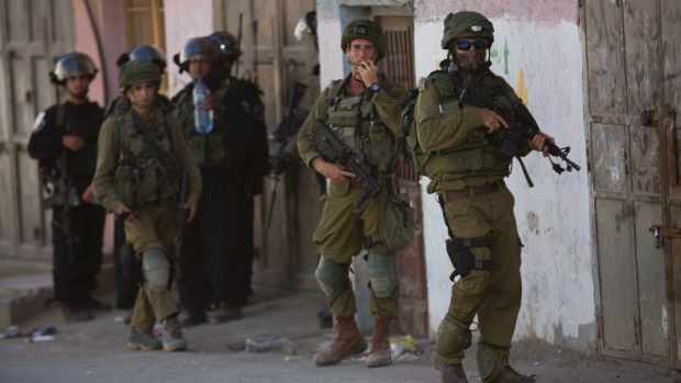 Israeli security forces during clashes in the Fawwar refugee camp near Hebron in August.