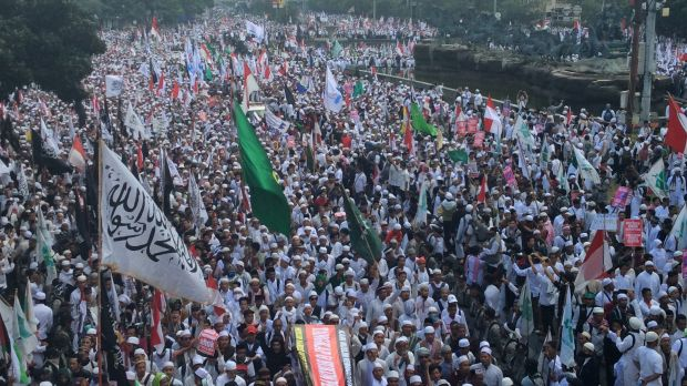 Demonstrators rallied in Jakarta after Friday prayers to demand the arrest of the city's governor, Ahok.