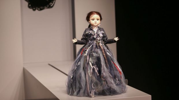 A miniature mannequin jerkily traverses the runway at the NGV.