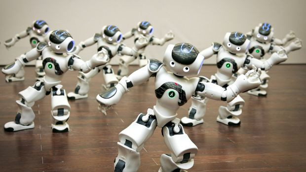 A group of programmable humanoid Nao robots, developed by a French company Aldebaran Robotics, perform dance inside the ...