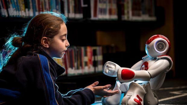 Grade 4 student Romy Szmulewicz with robot Rosey at the Biallik College. 7 November 2016. The Age NEWS. Photo: Eddie Jim.