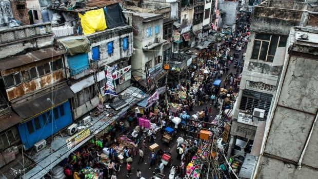 Old Delhi: crumbling city walls, labyrinths of tiny lanes always crowded with rickshaws and people walking in every ...
